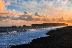 Black Sand Beach in Iceland. In 1991, the US journal Islands Magazine counted this beach as one of the ten most beautiful beaches on Earth. Its stretch of black stock photo