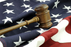 US Justice. Wooden Gavel and American Flag Royalty Free Stock Image