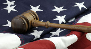 US Justice. Wooden Gavel and American Flag Royalty Free Stock Photography
