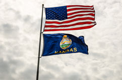US and Kansas Flags. United States and Kansas flags blowing in the wind Royalty Free Stock Photos