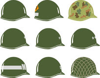 US M1 Army Helmets of WW2. Including Viet Nam 2nd Rangers Airborne Military Police MP, one two and three star generals and Captain Stock Photos