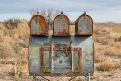 US Mail Boxes. Rusty mail boxes in rural New Mexico royalty free stock images