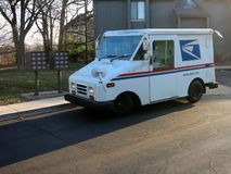 US Mail Truck. A US Mail truck is stopped at a residential address delivering mail royalty free stock photography