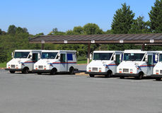 US Mail Trucks. Row of United States Postal Service Mail Trucks in Parking Lot Royalty Free Stock Image