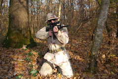 Us Marine. In a forest aiming with his rifle sniper Royalty Free Stock Photos