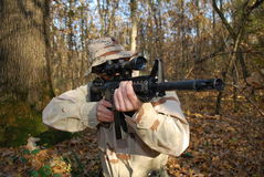 Us Marine. In a forest aiming with his rifle sniper Royalty Free Stock Photography