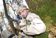 Us Marine. In a forest aiming with his rifle sniper Royalty Free Stock Photo