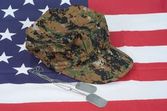 Us marine camouflage cap with blank dog tag on us flag backgroun. D Stock Image