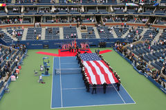 US Marine Corps unfurling American Flag during the opening ceremony of the US Open 2014 men final Stock Image