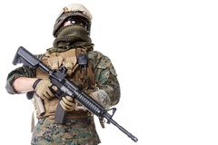 US Marine Soldier. Studio shot of United States Marine with rifle weapons in uniforms. Proudly looking, low angle shot. Military equipment, army helmet, combat Royalty Free Stock Images