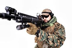 US Marine Soldier. Studio shot of United States Marine with rifle weapons in uniforms. Military equipment, army helmet, combat boots, tactical gloves. Isolated Stock Image