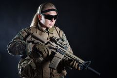US Marine Soldier. Studio shot of United States Marine with rifle weapons in uniforms. Military equipment, army helmet, combat boots, tactical gloves. Isolated Royalty Free Stock Image