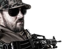 US Marine Soldier. Studio shot of United States Marine with rifle weapons in uniforms turning around. Military equipment, army helmet, black glasses, tactical Stock Image