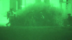 US Marine Take Prisoner. BRAWLEY CALIFORNIA, MAY 2013, Night vision camera. US Marine soldiers take a prisoner infront of a house at night stock video footage