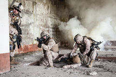 US marines in action. Squad of US marines in action in ruined building royalty free stock photo