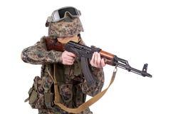 US MARINES with kalashnikov assault rifle. Isolated on white stock image