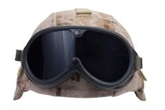 Us marines kevlar helmet with desert camouflage cover and protective goggles Stock Photos