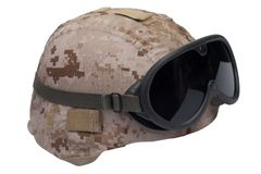 Us marines kevlar helmet with desert camouflage cover and protective goggles Royalty Free Stock Photos