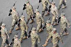 US Marines march during military parade. BUCHAREST, ROMANIA - DECEMBER 1: Aerial photo with United States marines soldiers marching during the Romania's National Royalty Free Stock Image