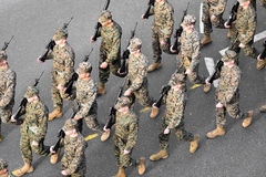 US marines marching. BUCHAREST, ROMANIA - DECEMBER 1: Aerial photo with United States marines soldiers marching during the Romania's National Day military parade stock images