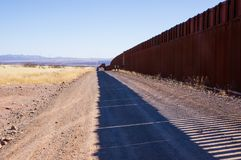 The US-Mexico border wall in Arizona desert royalty free stock photos