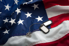 US Military dog Tags and the American Flag Stock Image