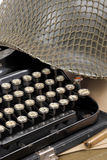 US military helmet of the Second World War with old typewriter Royalty Free Stock Photo