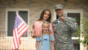 US military man with family showing keys from house, benefits in crediting. Stock footage stock video