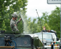US Military member getting sprayed with a lot of water. Stock Photos