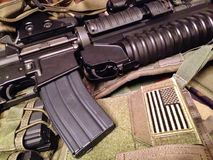 US military still life. M4A1 carbine with M203 grenade launcher on tactical vest Stock Images