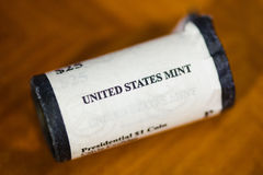 US mint roll of presidential dollar coins Royalty Free Stock Photography