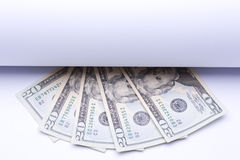 Us money dollar, banknotes under roll of paper Royalty Free Stock Image