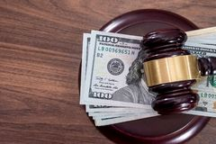 Us Money with judges hammer. On wooden table, top view stock image