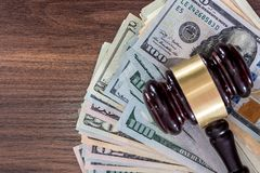 Us Money with judges hammer on wooden table. Top view royalty free stock photos