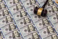 Us Money with judges hammer on wooden table. Top view royalty free stock photo