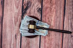 Us Money with judges hammer on wooden table. Top view royalty free stock image
