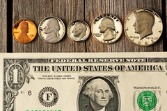 US money over wooden background Royalty Free Stock Photography