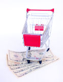US money and shopping trolley Stock Images