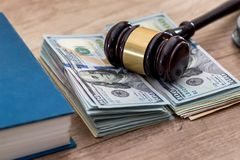 Us Money with wooden hammer handcuffs. Law  book Royalty Free Stock Photos