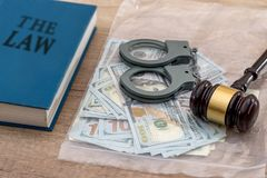 Us Money with wooden hammer handcuffs, law. Book Stock Photography