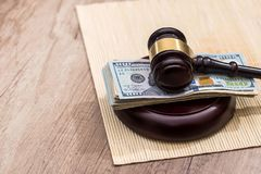 Us money with wooden judges hammer on table. Top view royalty free stock images