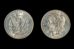 An 1885 US Morgan Dollar, isolated on black stock images