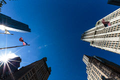 US national flag on the sky. US national flag on the clear blue sky background Stock Photography