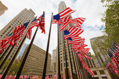 US national flags skyscrapers. US national flags on the street near skyscrapers editorial Royalty Free Stock Photography
