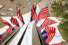 US national flags skyscrapers. US national flags on the street near skyscrapers editorial Royalty Free Stock Photo