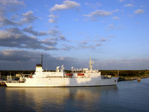 US Naval Ship In Sunset Light Stock Images