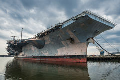US Navi aircraft carrier warship in the port.  stock photo