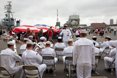US Navy Band plays in front of US Flag Stock Photo