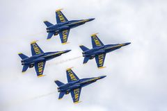 US Navy Blue Angels Hornet Fighter Jets Flying In Formation Closeup. Closeup of US Navy Blue Angels Hornet Fighter Jets flying in formation at McDill Air Force royalty free stock photos