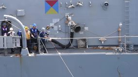 US Navy Crewmember Pull Tow On Board stock footage